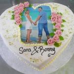 Hochzeitstorte Herz mit Bild und Blumen